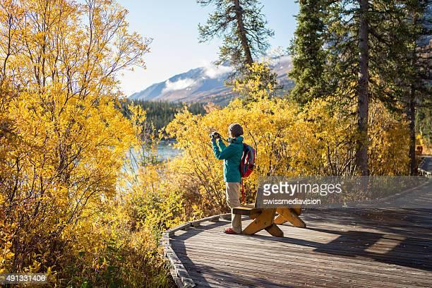 Hiker taking picture of landscape-Autumn