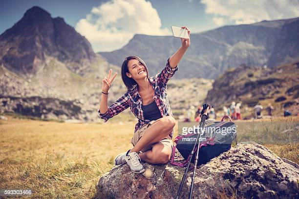 Hiker taking selfie