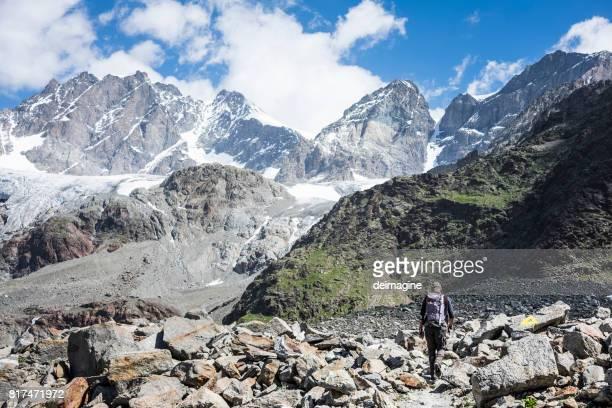 Hiker trekking on mountain path