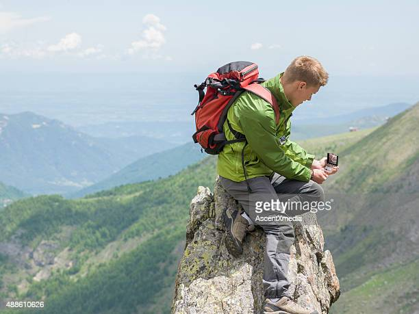 Hiker uses compass for direction finding