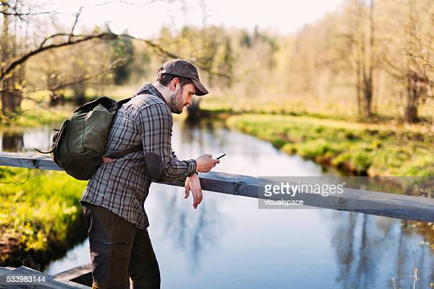 Hiker Using Smartphone in Nature
