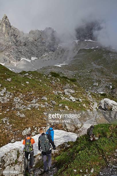 Hiker walk to the 'Lampsenspitze' at the Karwendel region on June 13 2014 near Vomp Austria The Karwendel is the largest range of the Northern...