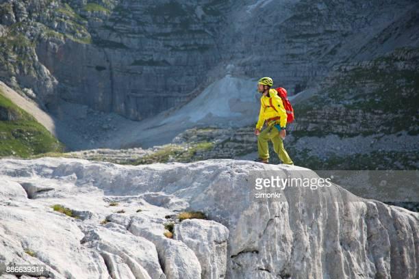 Hiker walking on a rock