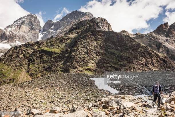 Hiker walking on mountain path