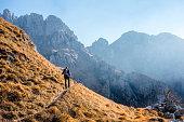 Hiker walking on mountain trail