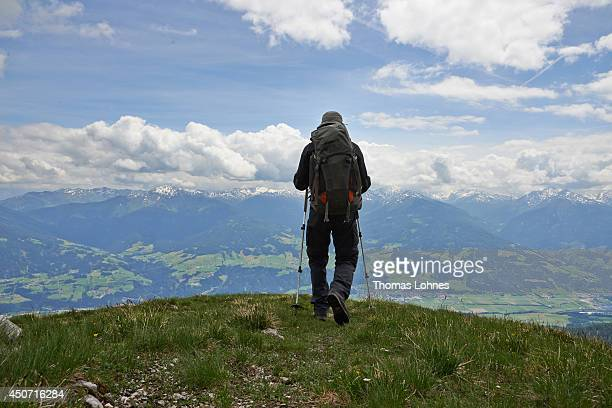 A hiker walks at the mountain 'Niedernissl' at the Karwendel region on June 13 2014 near Vomp Austria The Karwendel is the largest range of the...