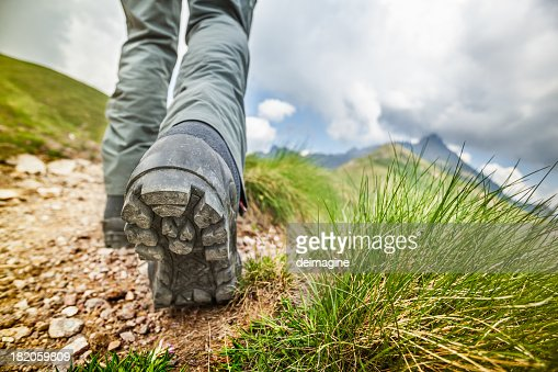 Hiker walks on Mountain Trail