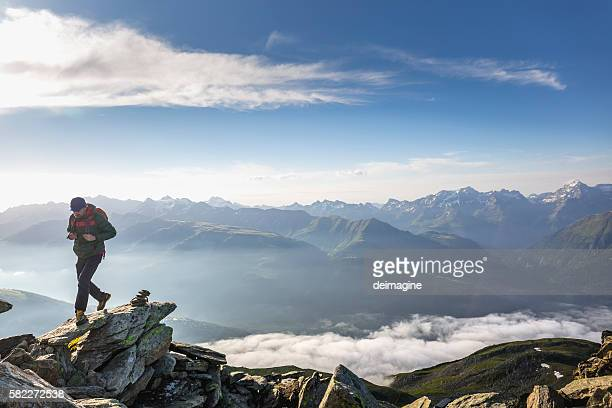 Hiker walks on mountains trail