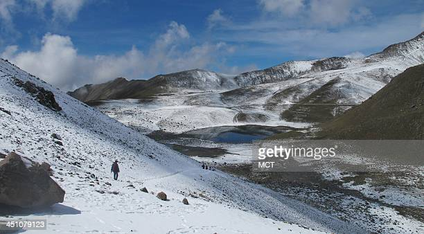 A hiker wends down a slope into the crater of Nevado de Toluca volcano in Mexico July 7 2012