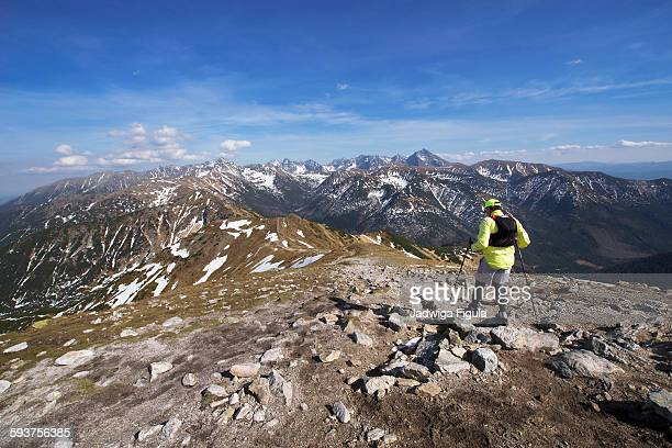 Hiker with panoramic view on Tatra Mountains