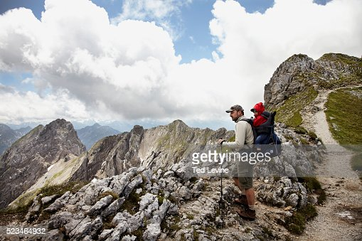 Hiker with son (2-3) in mountain landscape