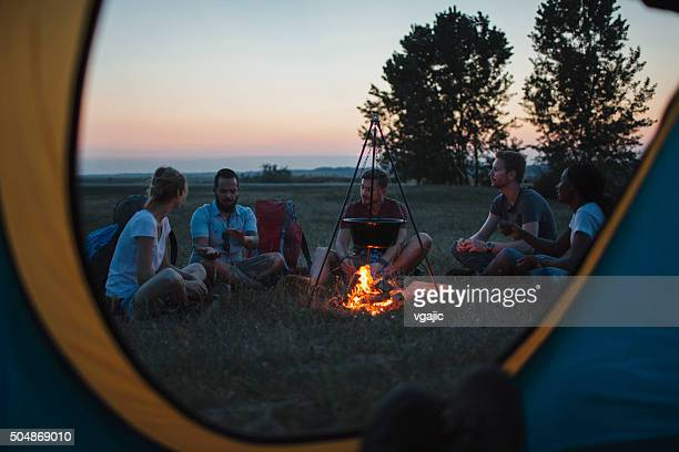 Hikers Around Campfire