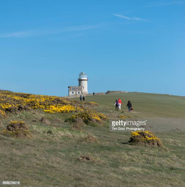 Hikers at Belle Tout Lighthouse at Beachy Head