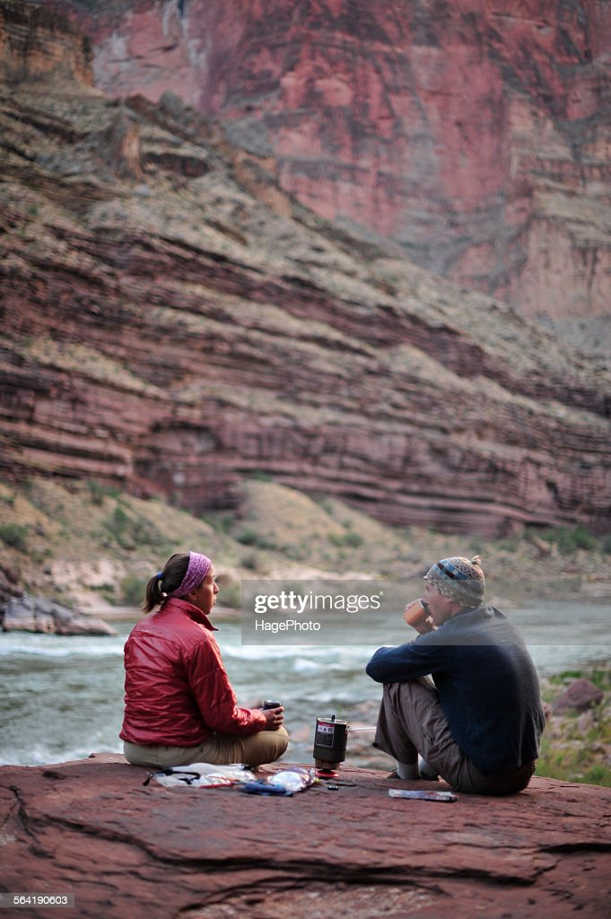 Hikers cook dinner on a cliff-pinched patio above camp and the Colorado River near Deer Creek Falls in the Grand Canyon outside of Fredonia, Arizona November 2011.