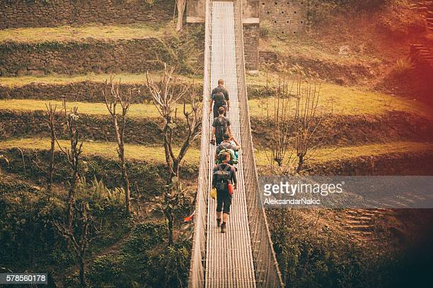 Hikers crossing the footbridge