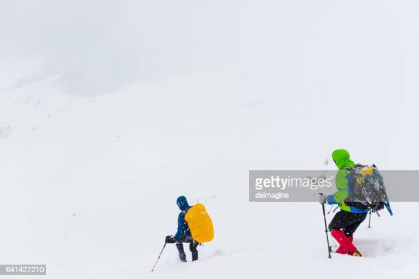 Hikers descend the mountain during snowstorm