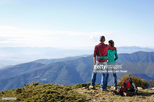 Hikers enjoying view from hilltop, Montseny, Barcelona, Catalonia, Spain