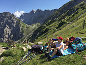 Hikers family members of the photographer on day three of a fourday 50km hike across the Karwendel mountain range take a break as their destination...