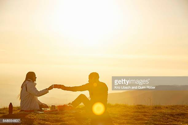 Hikers having picnic on hilltop, Montseny, Barcelona, Catalonia, Spain