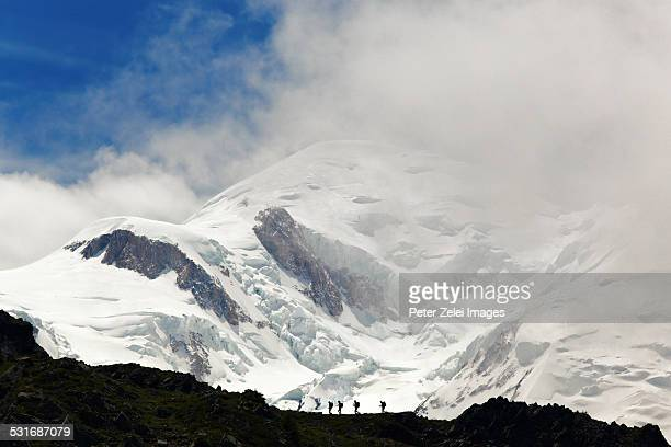 Hikers in front of the Mont Blanc