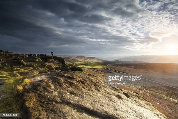 Hikers in Peak District during autumn sunset