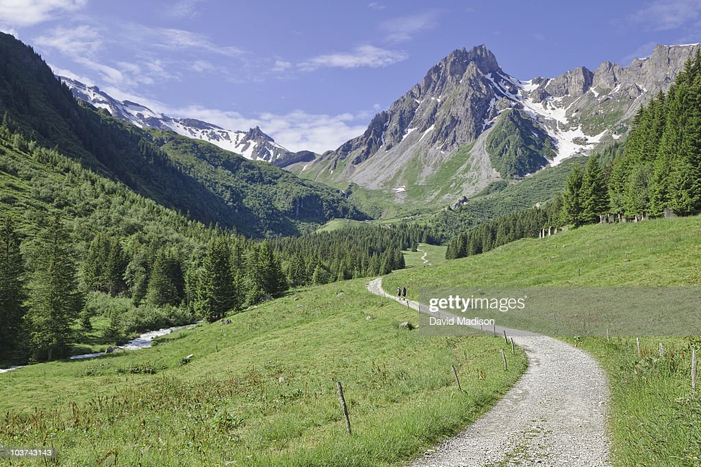 Hikers on Mont Blanc circuit trail. : Stock Photo