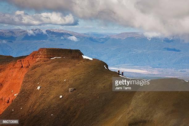 Hikers on mountain ridge, Tongariro Crossing, Tongariro National Park, North Island, New Zealand