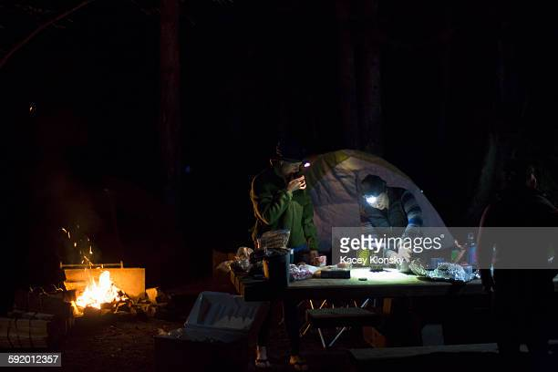 Hikers preparing dinner at camp