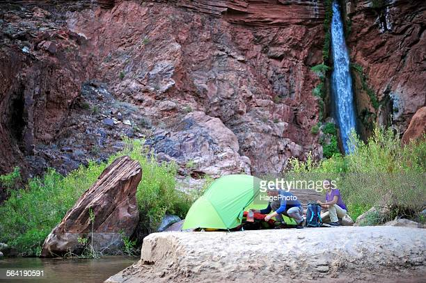 Hikers setup camp on a beach along the Colorado River near the plumeting 180-foot Deer Creek Falls in the Grand Canyon outside of Fredonia, Arizona November 2011.