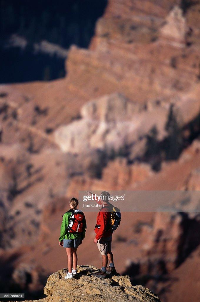 Hikers Standing on Mountain Peak