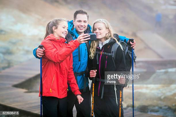 Hikers taking self portrait on volcanic landscape