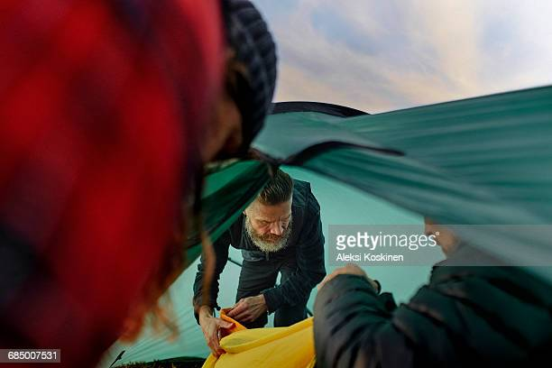 Hikers unpacking inside tent
