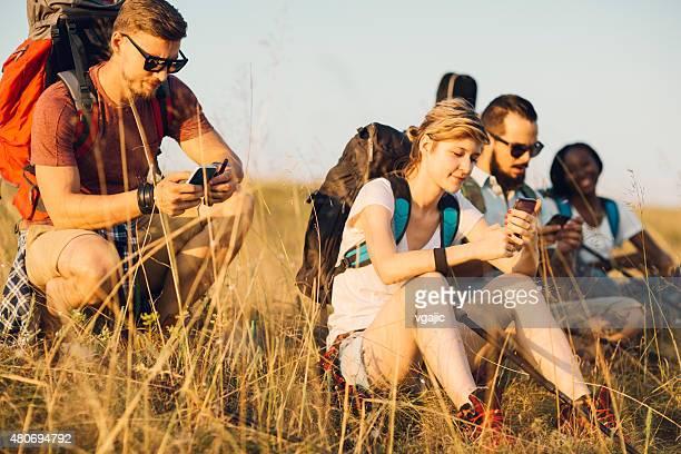 Hikers Using Smart Phones.