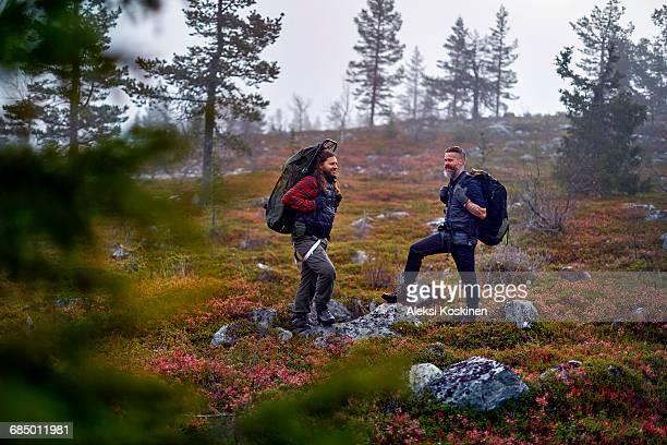 Hikers waiting in park, Sarkitunturi, Lapland, Finland