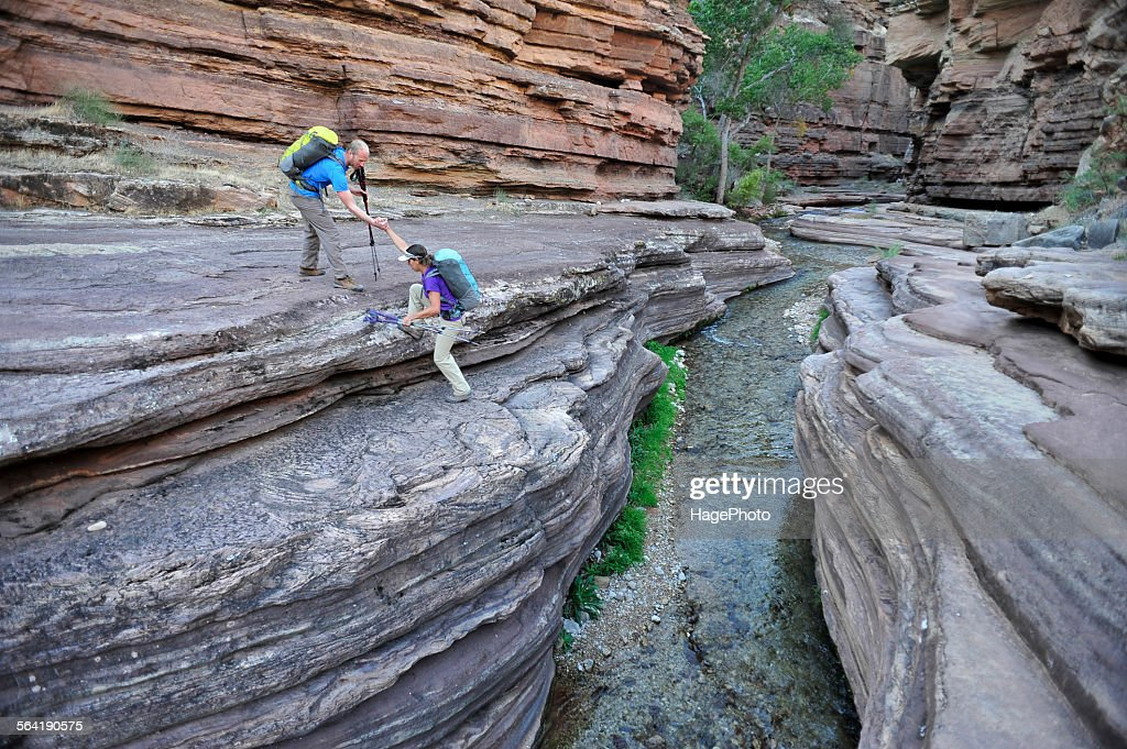 Hikers walk along Deer Creek Narrows in the Grand Canyon outside of Fredonia, Arizona November 2011.