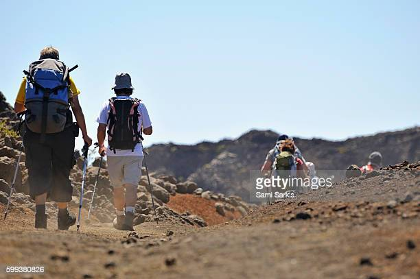 Hikers walking in the Haleakala crater, Haleakala National Park, Maui Island, Hawaii Islands, Usa