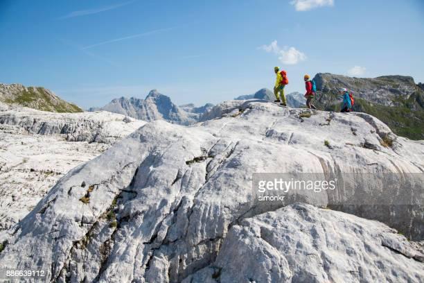 Hikers walking on a rock mountain