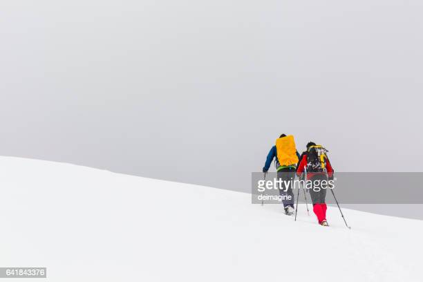 Hikers with snowshoes on snowy plateau