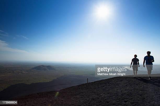 Hikiers climb Cerro Negro for Volcano Boarding.