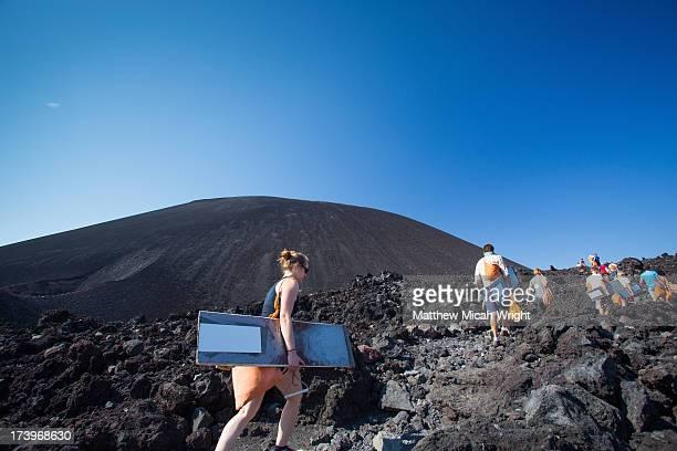 Hikiers climb Cerro Negro for Volcano Boarding