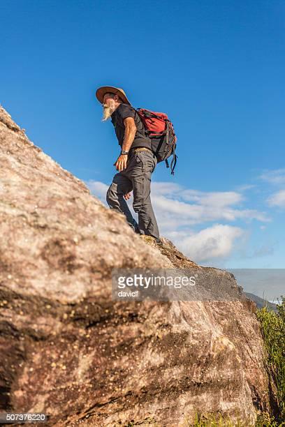 Hiking Active Senior Man Rock Climbing in Australian Mountains