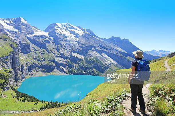 Hiking at Lake Oeschinensee in Berner Oberland in Central Switzerland