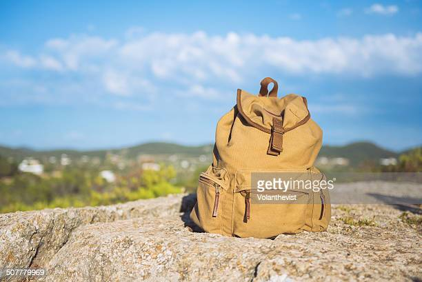Hiking backpack on a rock in the countryside