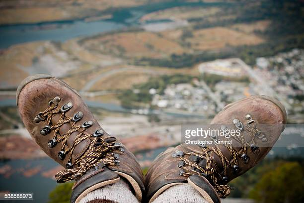 Hiking boots on edge of Chief Mountain.