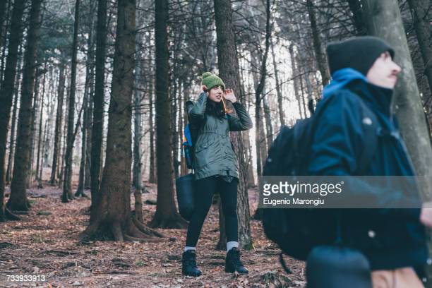 Hiking couple in forest, Monte San Primo, Italy