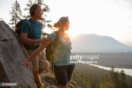 Hiking couple pause to look back on route below