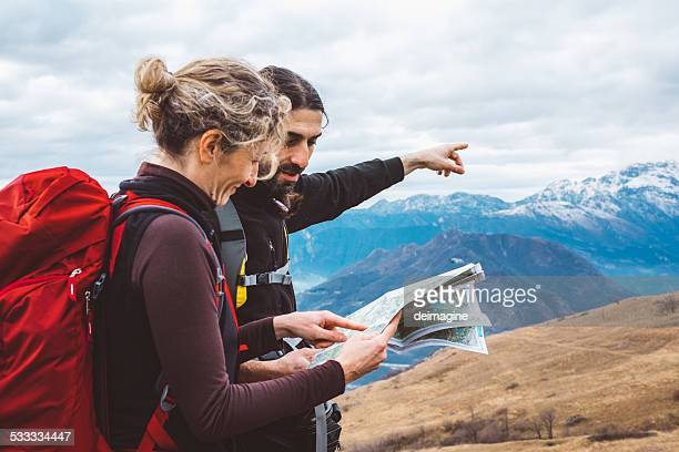 Hiking couple with map in mountain