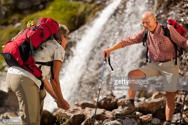 hiking couple with rucksacks