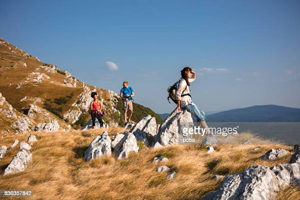 hiking friends enjoy the view on mountain peak