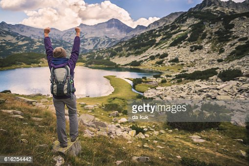 Hiking in mountains and enjoying a view from above : Foto de stock